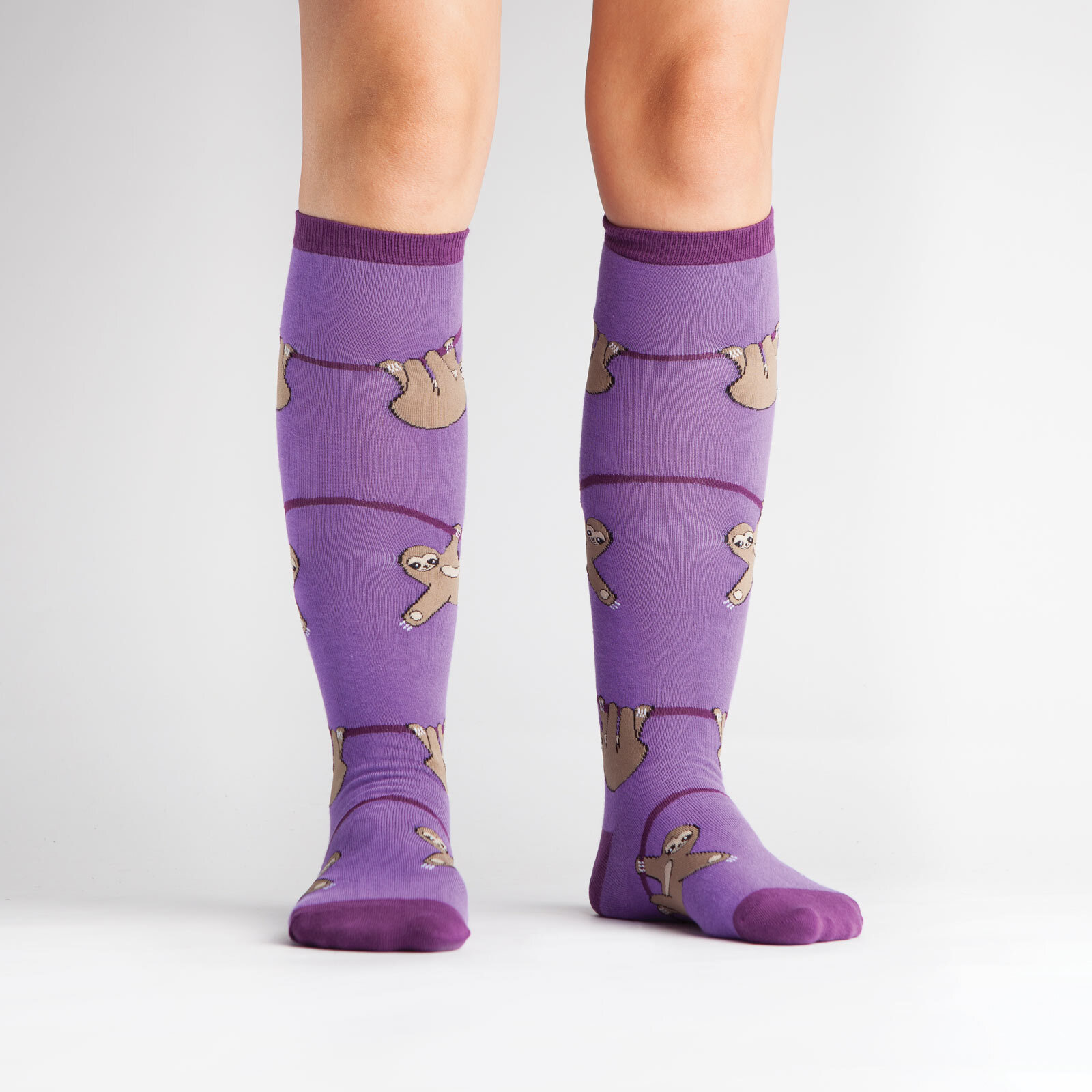 model wearing Sloth Knee High Socks Purple - Women's