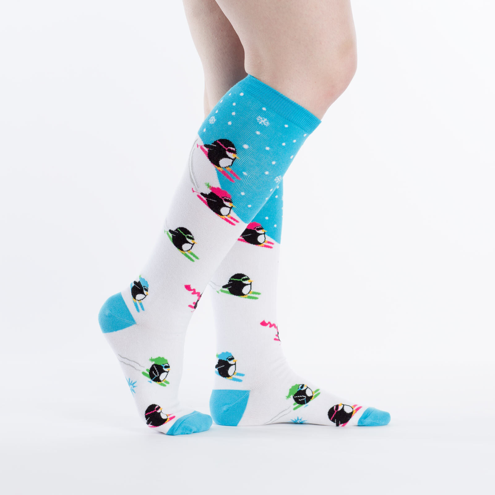 model side view of Downhill Penguins - Skiing Penguin Friends Knee High Socks White - Women's