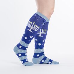 model side view of Mazel Toes - Hanukkah Menorah and Dreidel Knee High Socks Blue - Women's