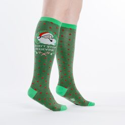 model side view of Don't Stop Believing - Santa Claus Holiday Knee High Socks Green - Women's