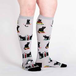 model wearing Booked for Meow - Cats and Books Knee High Socks Grey - Women's