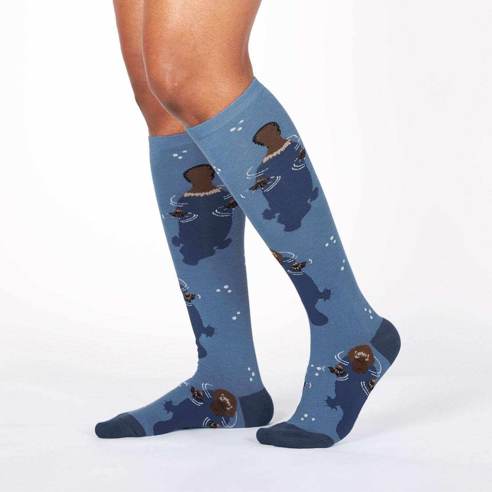 model wearing Platypus - Floating and Swimming Platypuses Knee High Socks Blue - Women's