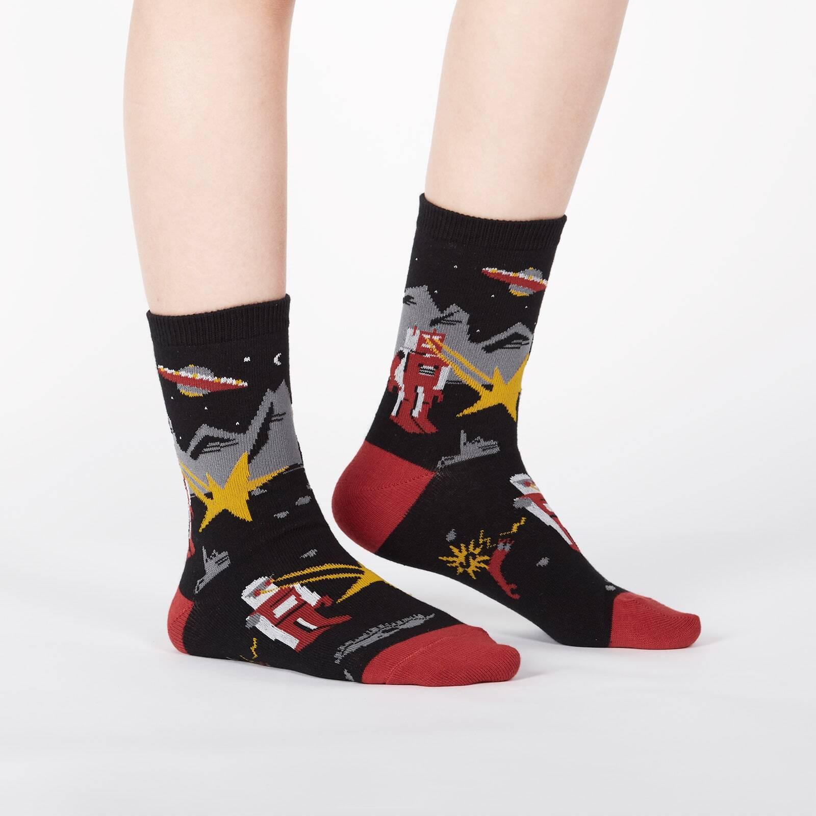 model wearing Zap! Zap! - Destructive Robots Dogs and UFOs Crew Socks Black - Junior's