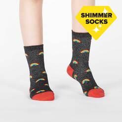 model wearing Glitter Over The Rainbow - Sparkling Shimmer Rainbow Beam Crew Socks Black - Junior's