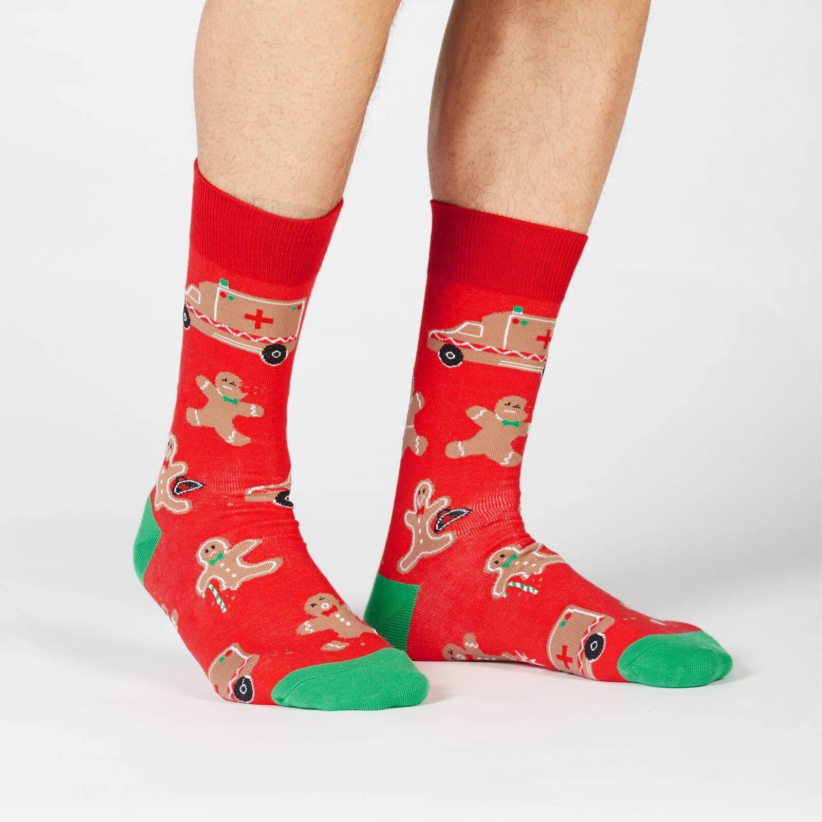 model wearing Break a Leg - Funny Gingerbread Cookie Crew Socks Red - Men's