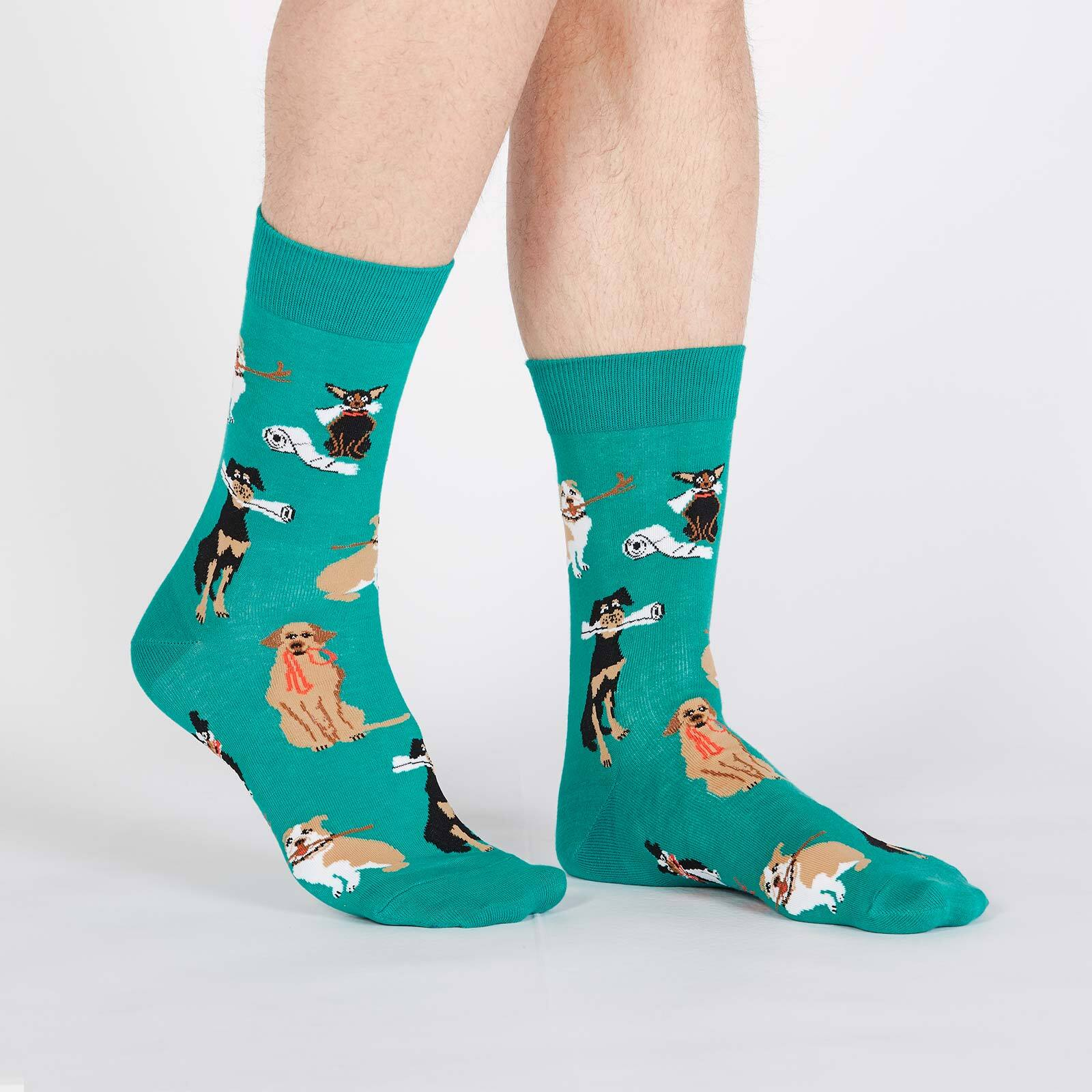 model wearing Chew on This - Dogs Doing Tricks Crew Socks Teal - Men's