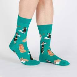 model wearing Chew on This - Dogs Doing Tricks Crew Socks Teal - Men's