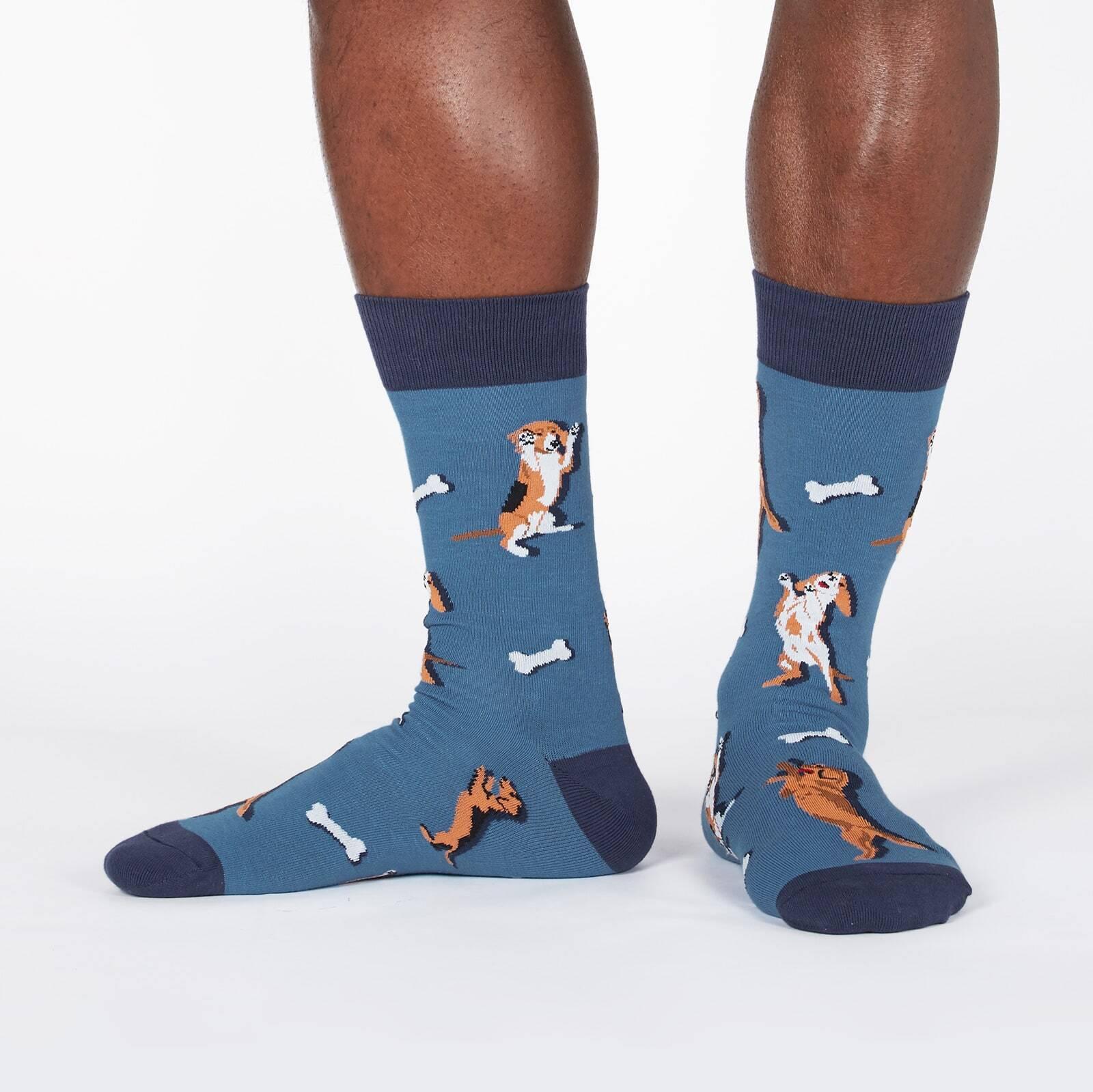 model wearing Raise the Woof - Dancing Dogs and Chew Bones Crew Socks Blue - Men's
