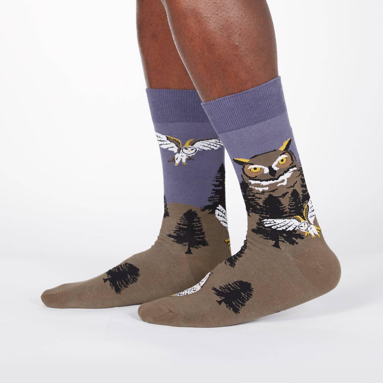 model wearing Owl Mountain - Great Horned Owl Barn Owl Nature Crew Socks Green - Men's