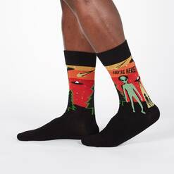 model wearing They're Here - UFO Alien Invasion Crew Socks Black - Men's