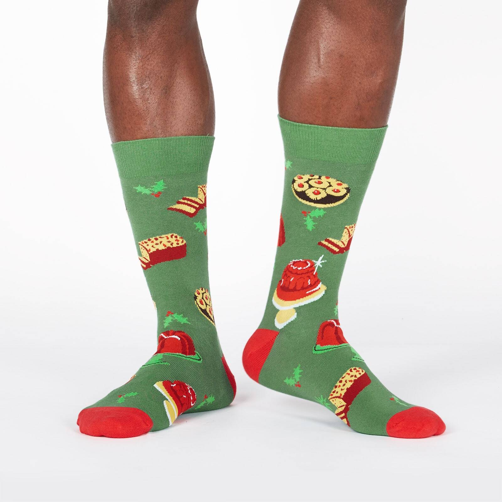 model wearing Getting Jiggly with It - Gelatin Dessert Christmas Holiday Dinner Crew Socks Green - Men's
