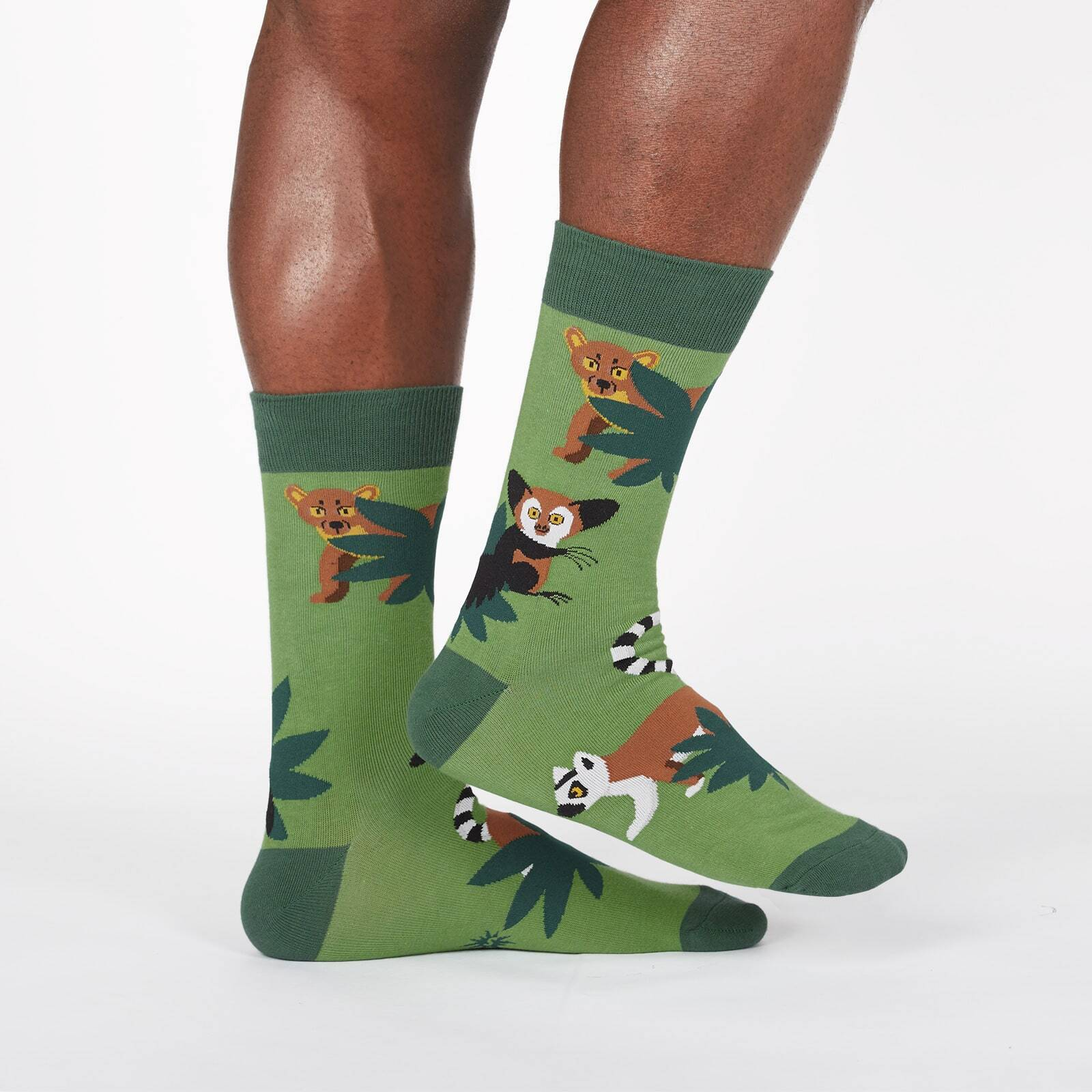 model wearing Madagascar Menagerie- Animals of Madagascar Africa Crew Socks Green - Men's