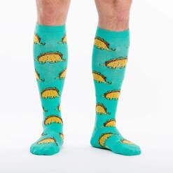 model wearing Tacosaurus - Wide Calf - Taco Dinosaur Knee High Socks Turquoise - Unisex