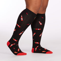 model side view of Hot Sauce - Wide Calf - Hot Sauce Knee High Socks Black - Unisex