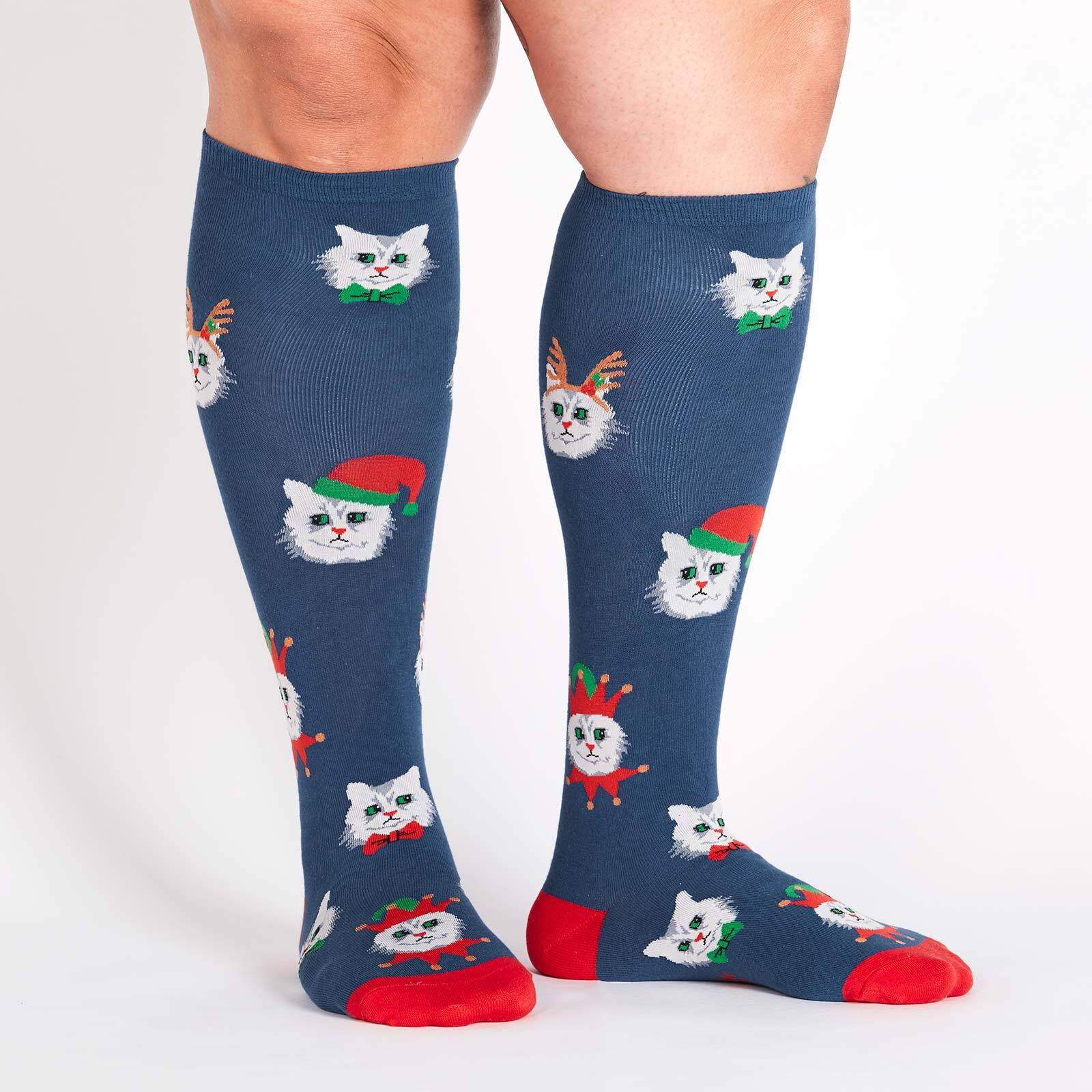 model wearing Santa Claws - Frowning Cats Dressed for Holiday Party Wide Calf Knee Socks Blue - Unisex
