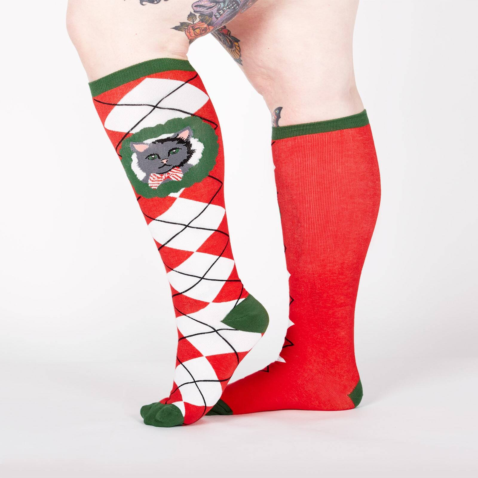 model wearing STRETCH-IT Deck the Paws - Wide Calf - Dog and Cat Holiday Argyle Christmas Knee High Socks Red - Unisex