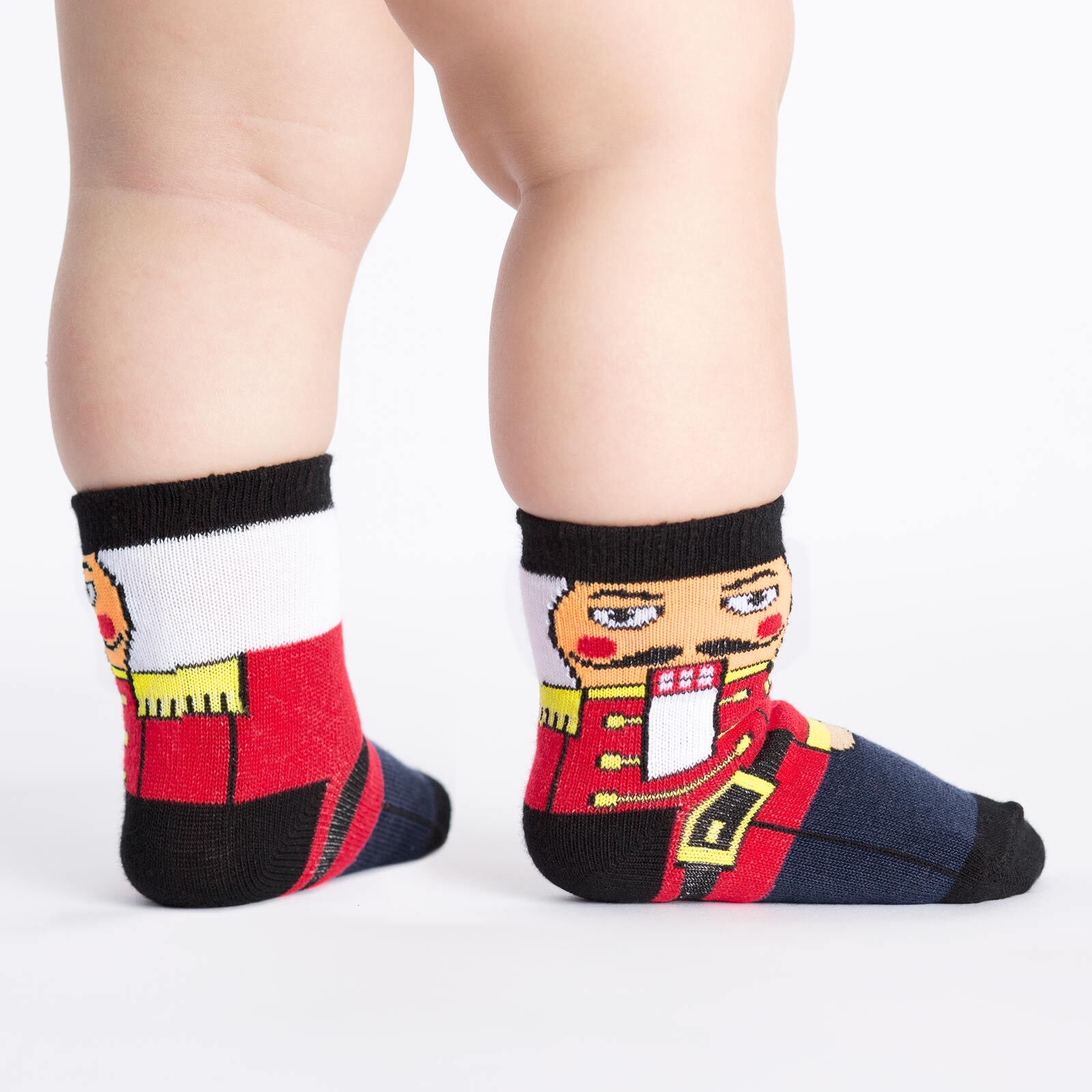 model side view of Nutcracker - Classic Holiday Wooden Nutcracker Soldier Crew Socks Navy Blue - Toddler