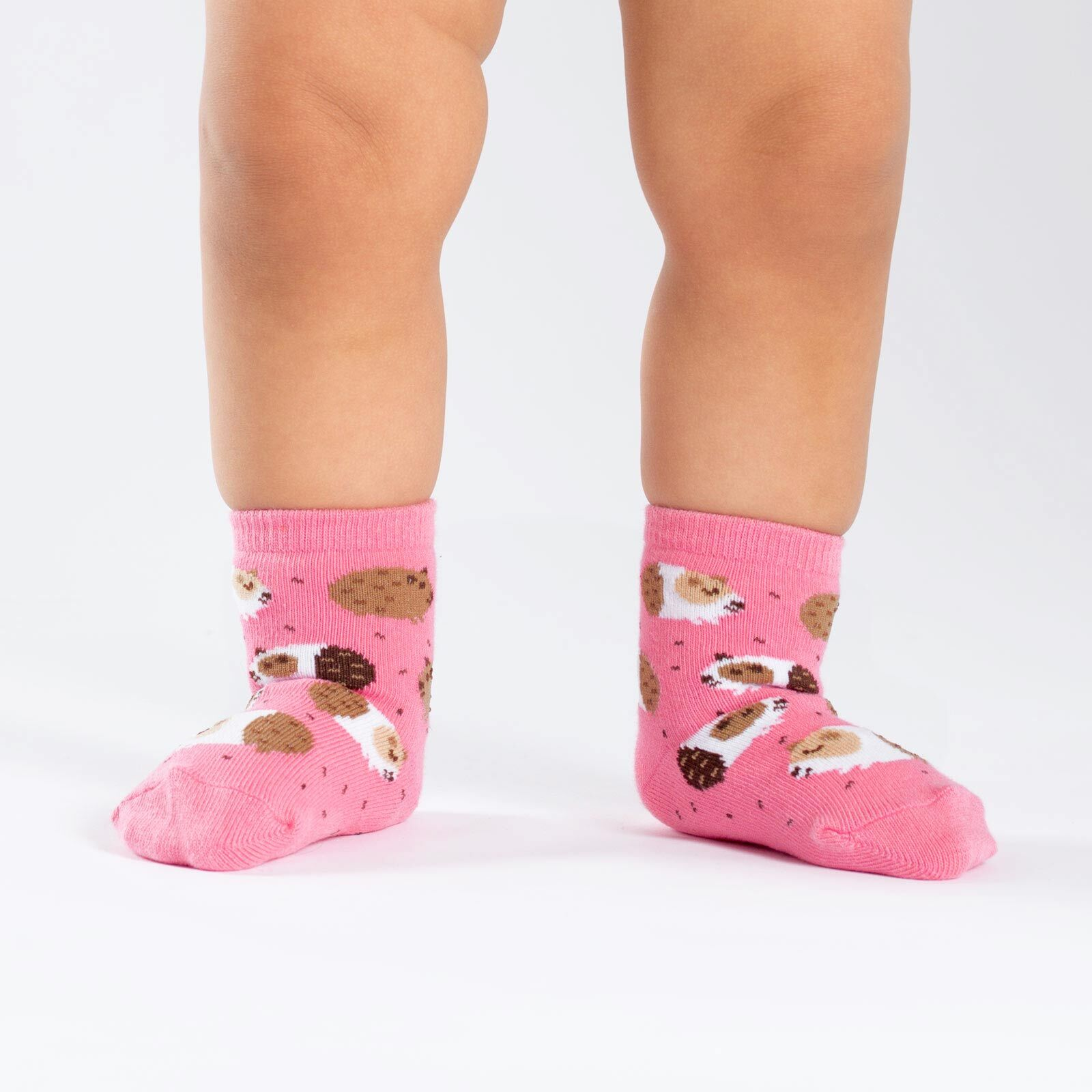 model wearing Guinea Piggin' Around - Guinea Pig Crew Socks Pink - Toddler
