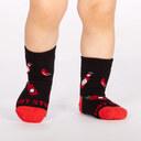 model wearing Mild Sauce - Hot Sauce Crew Socks Black and Red - Toddler