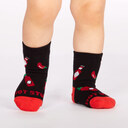model wearing Mild Sauce - Hot Sauce Crew Socks Black and Red - Toddler