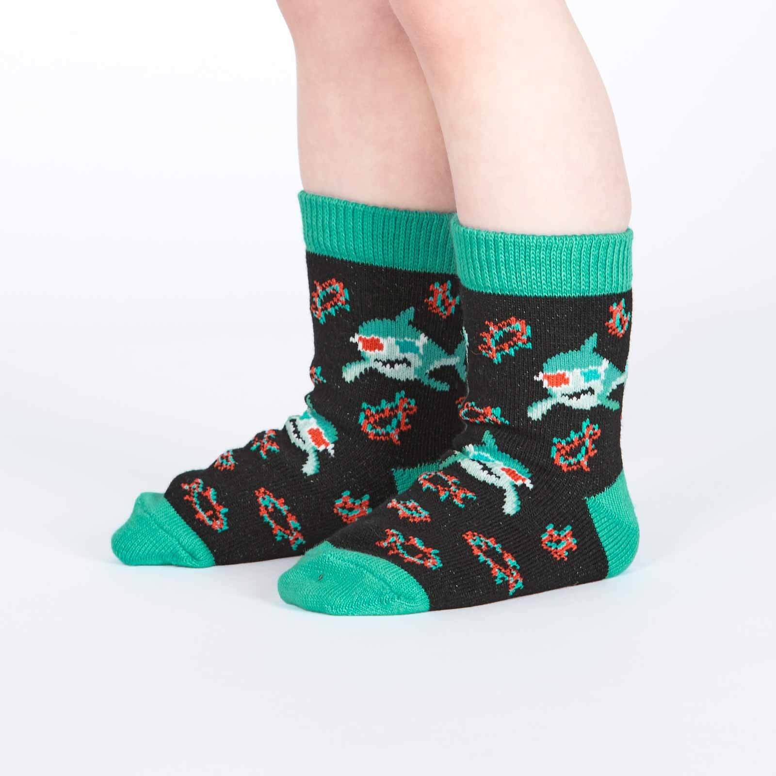 model side view of Jawsome - 3D Sharks Crew Socks Black - Toddler's