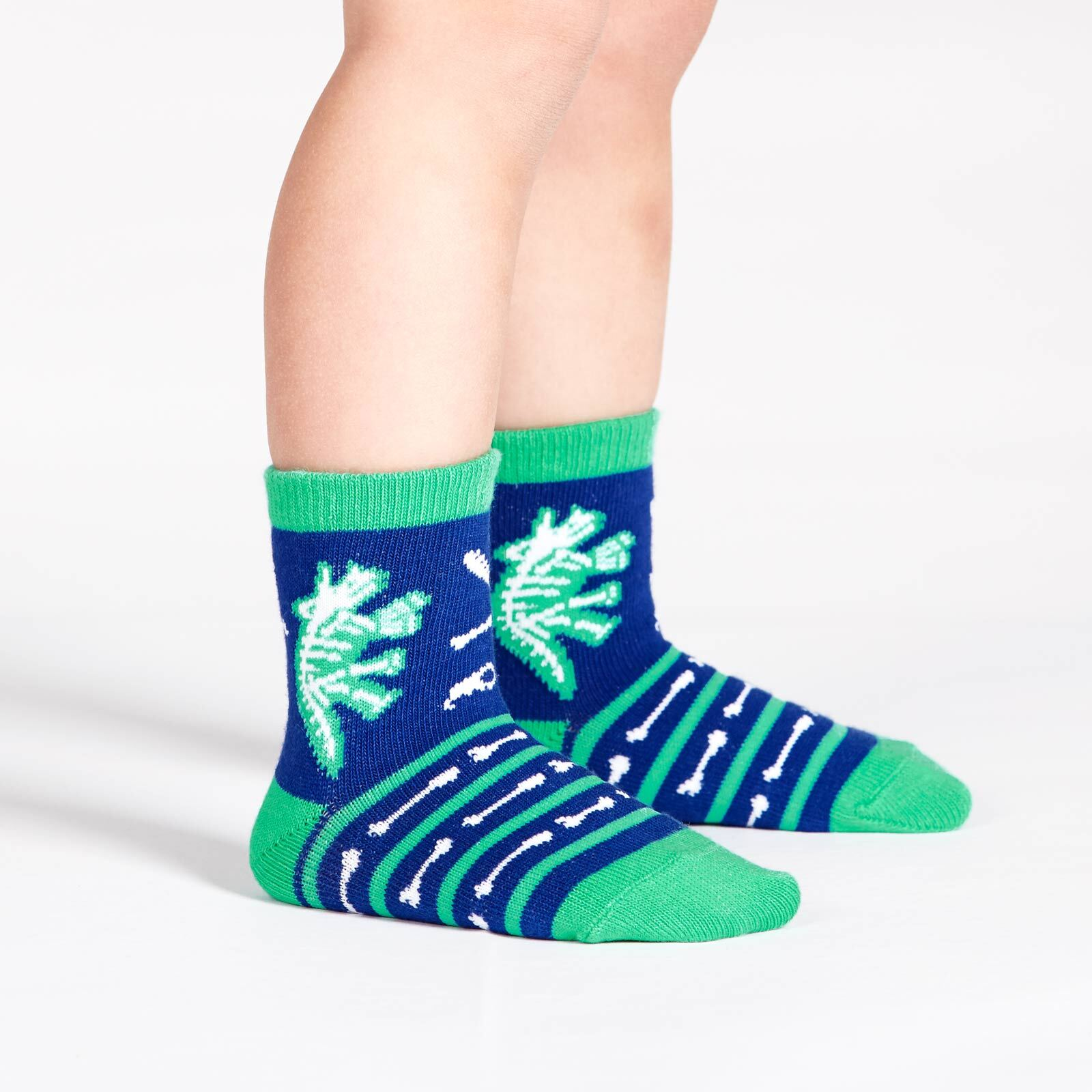 model wearing Arch-eology - Dinosaur Crew Socks Blue - Toddler