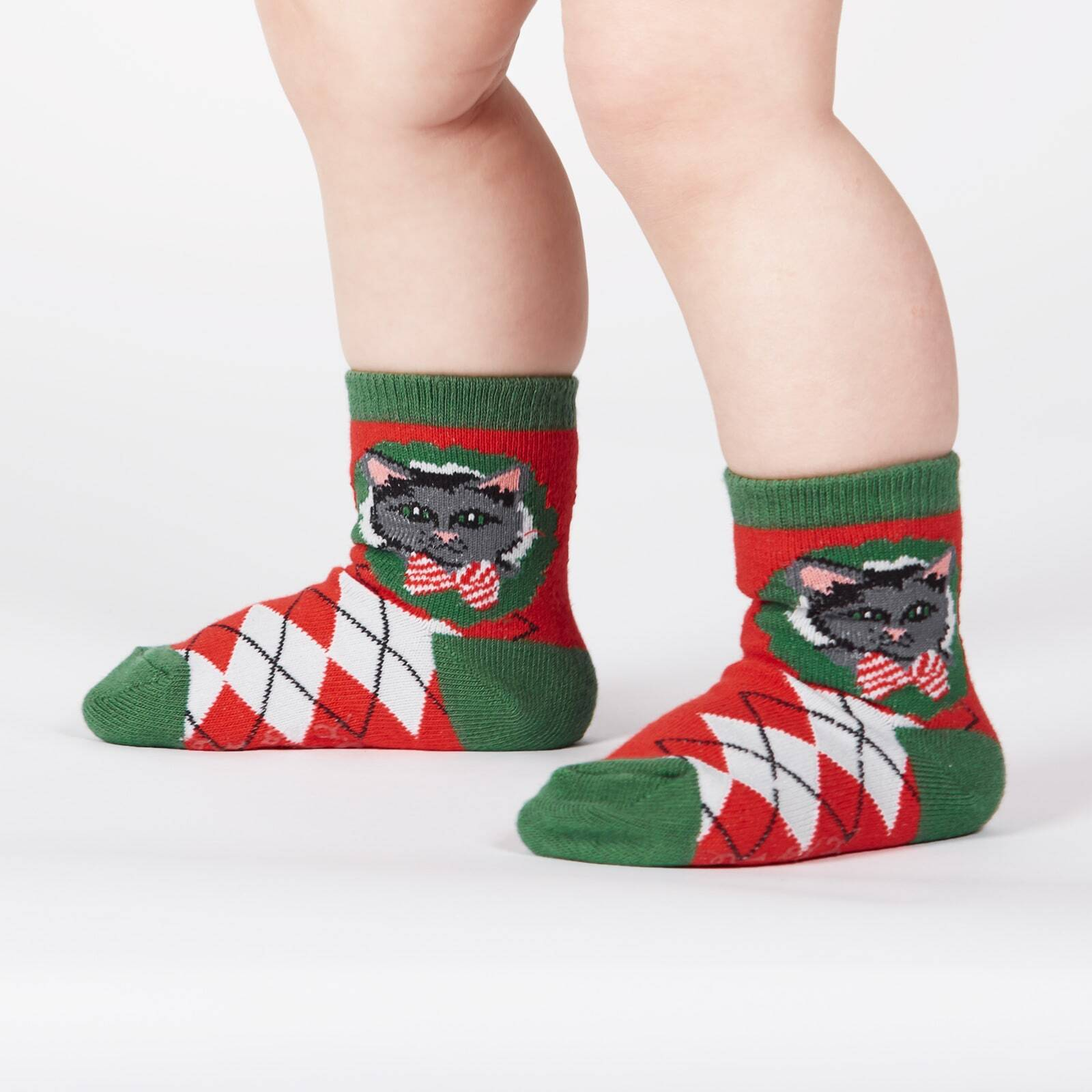 model wearing Deck the Paws - Dog and Cat Holiday Argyle Christmas Crew Socks Red - Toddler