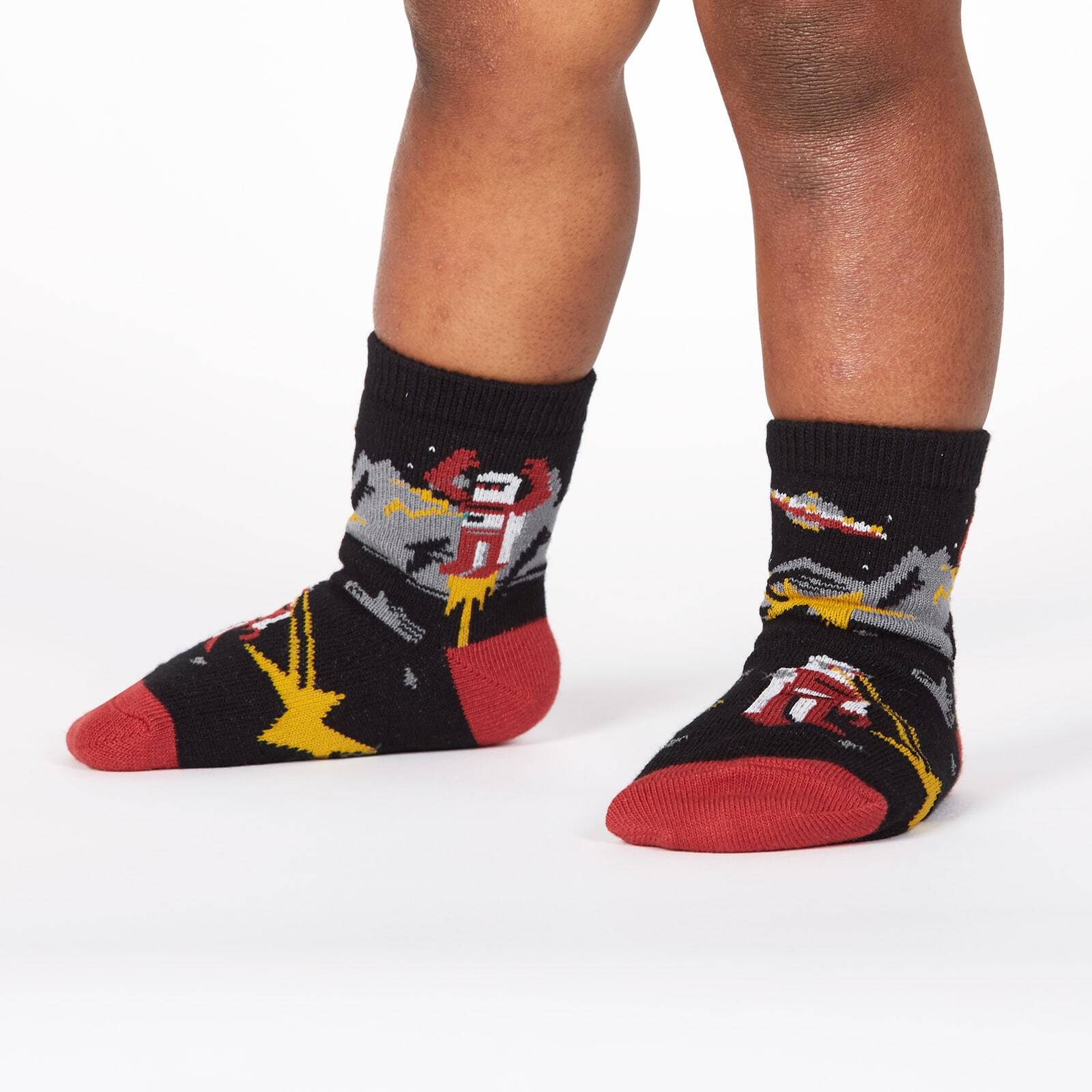model wearing Zap! Zap! - Destructive Robots Dogs and UFOs Crew Socks Black - Toddler