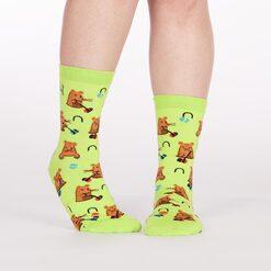 model wearing Whack-a-mole Crew Socks Lime Green - Women's