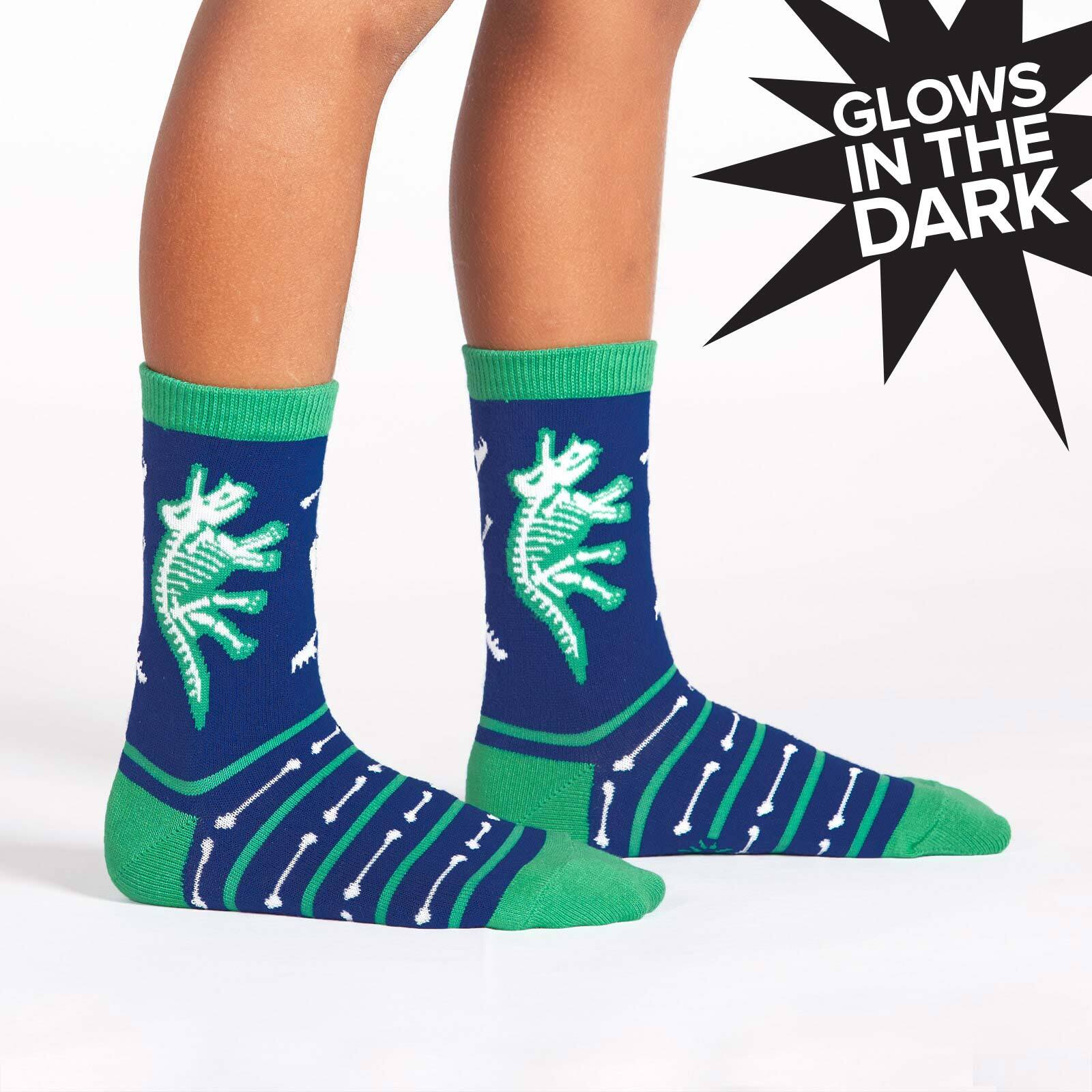 model wearing Arch-eology - Dinosaur Crew Socks Blue - Glow In The Dark - Youth