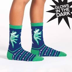 model wearing Arch-eology - Dinosaur Crew Socks Blue - Glow In The Dark - Youth