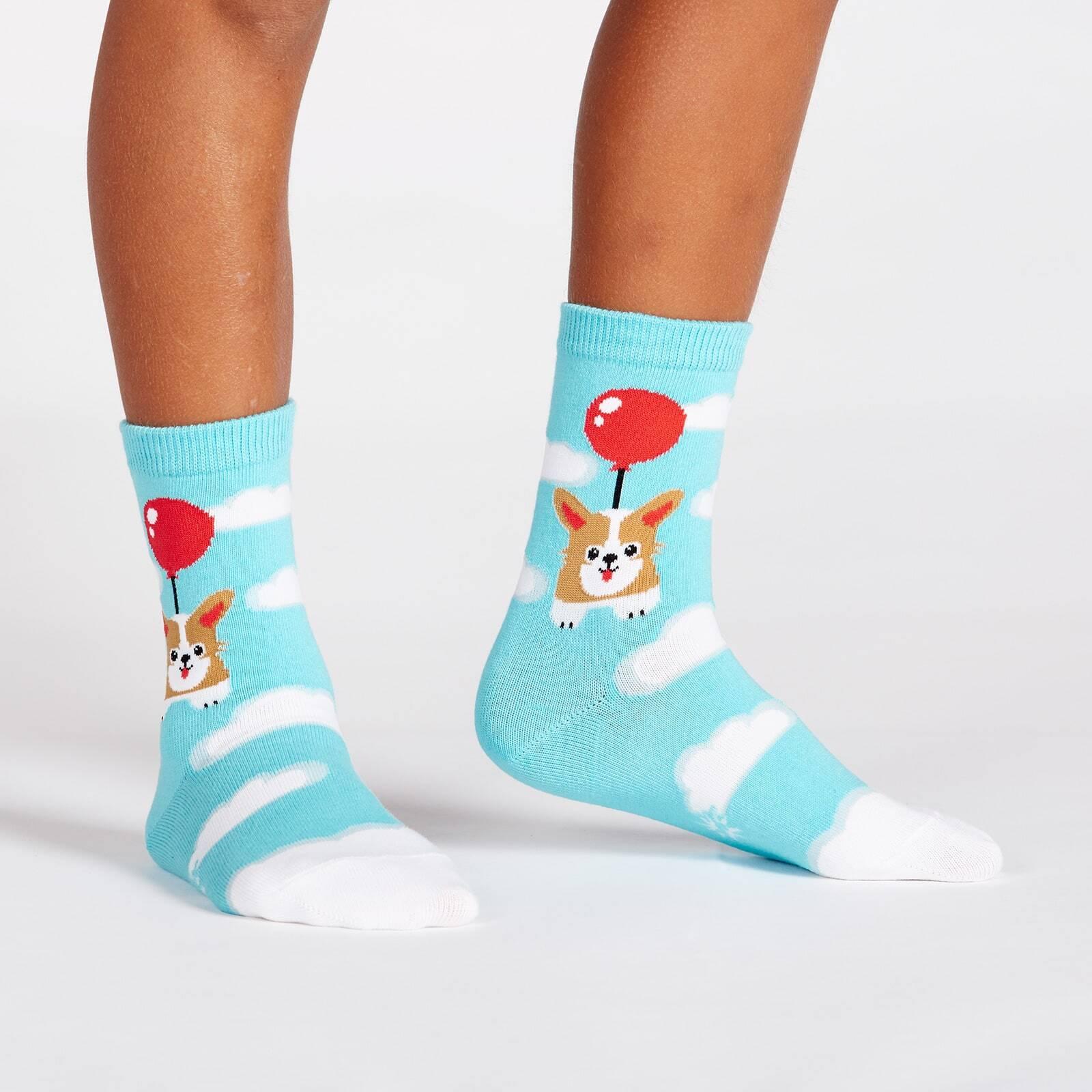 model wearing Pup, Pup, and Away Corgi Crew Socks Blue - Youth