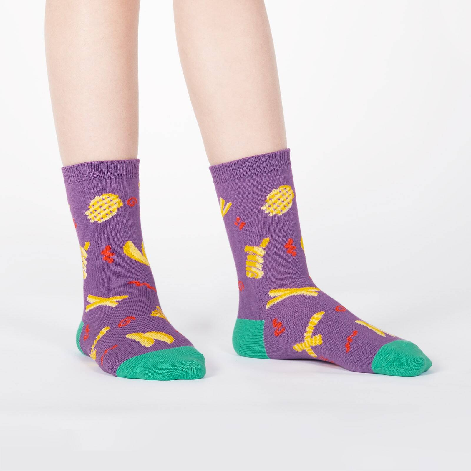 model wearing Everyday is Fry Day - All the French Fries on Crew Socks Purple - Youth