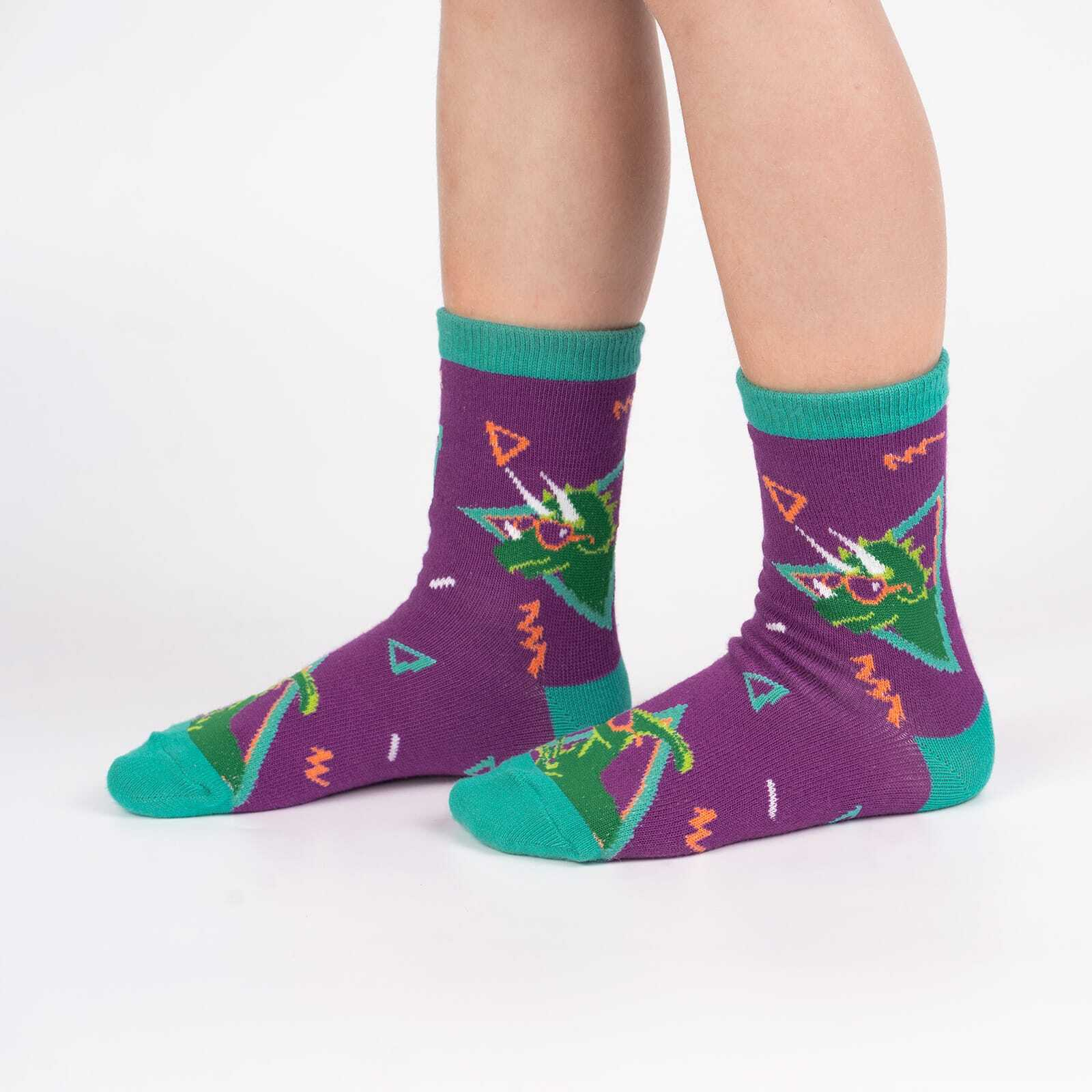 model wearing Jurassic Party - Dinosaur Fun Retro Crew Socks Purple - Youth