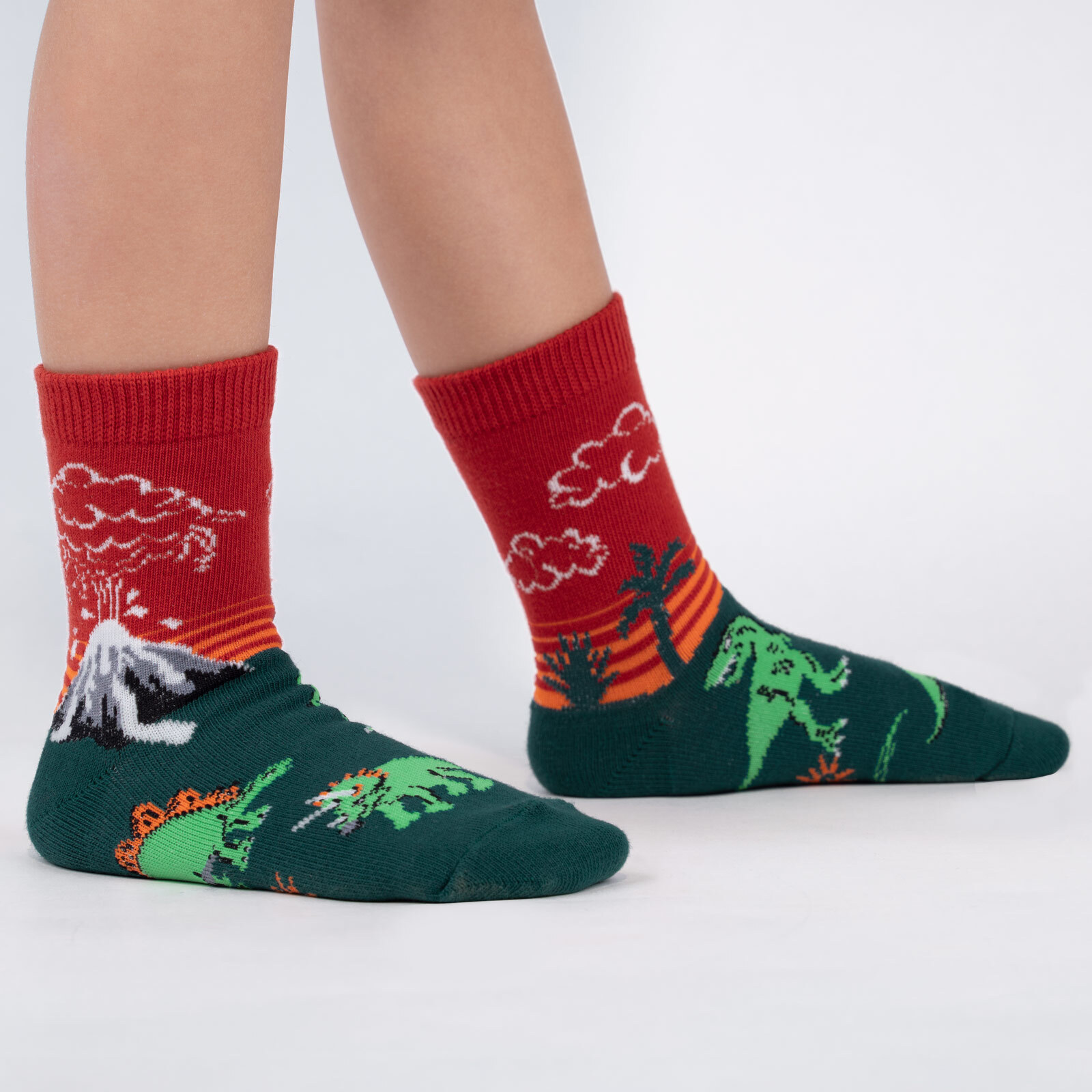 model wearing Dinosaur Days - Jurassic Volcano Crew Socks Red - Youth