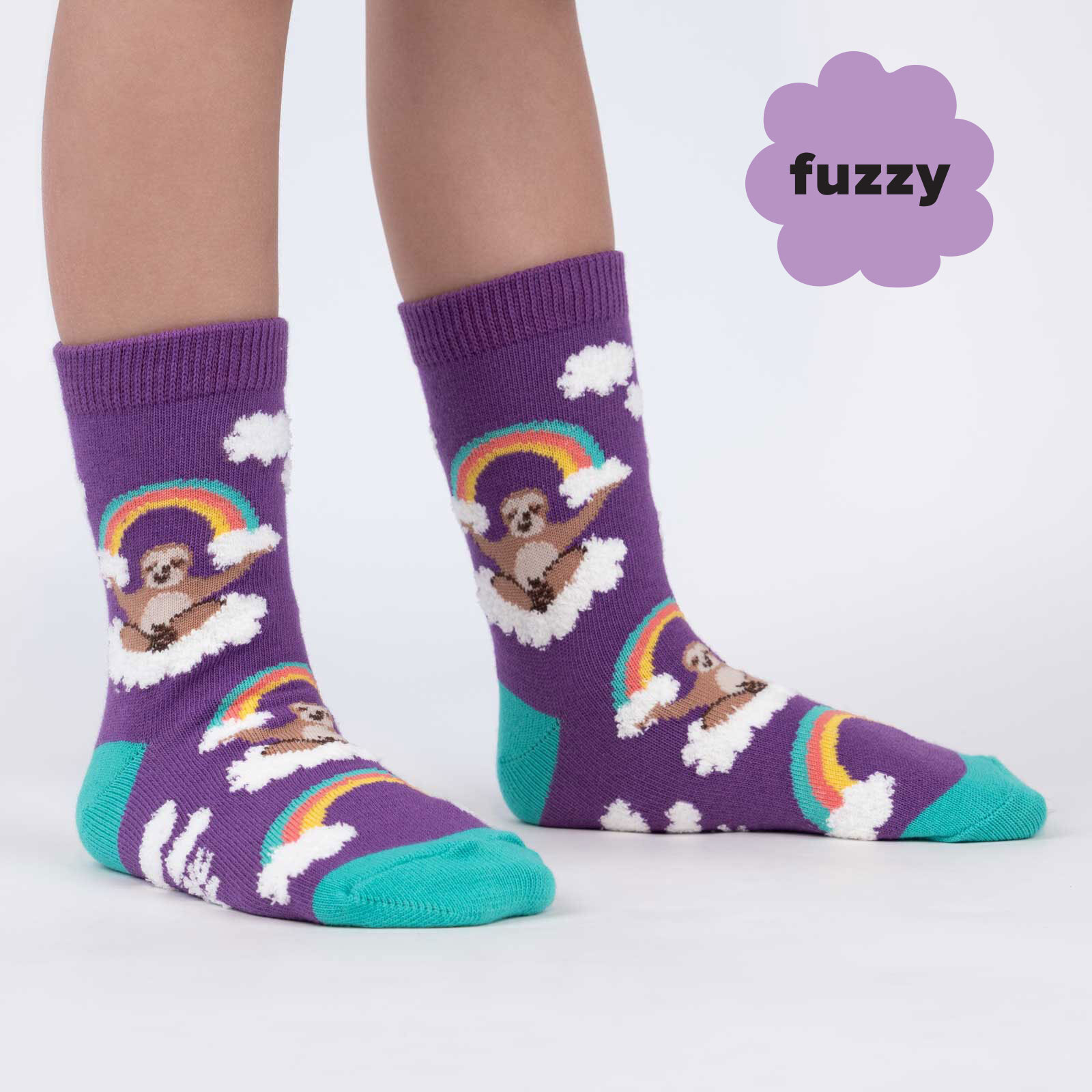 model wearing Sloth Dreams - Fuzzy Happy Rainbow Sloth Crew Socks Purple - Youth