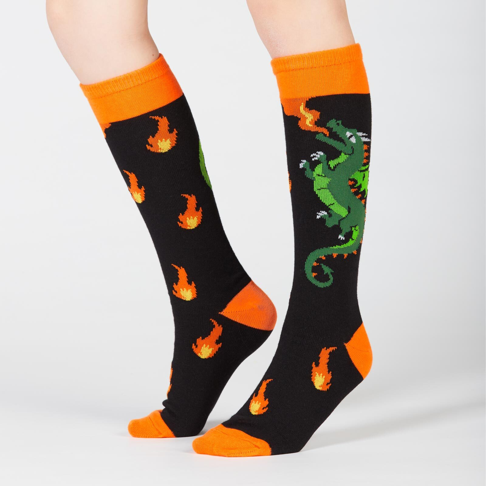 model wearing Spitfire - Dragon Knee High Socks Black and Orange - Youth