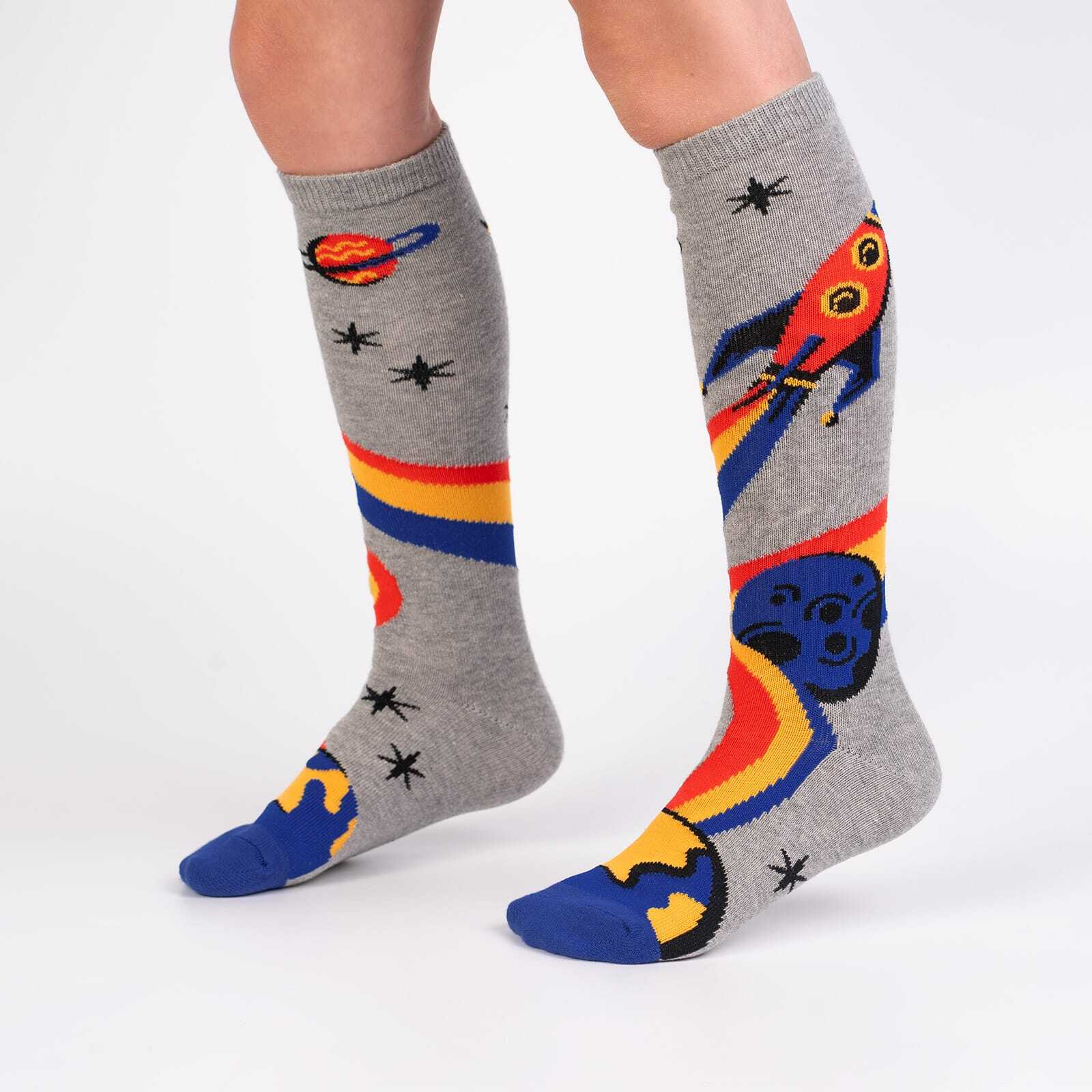 model wearing A Trip To The Moon - Rocket Ship Outer Space Knee Socks Grey - Youth