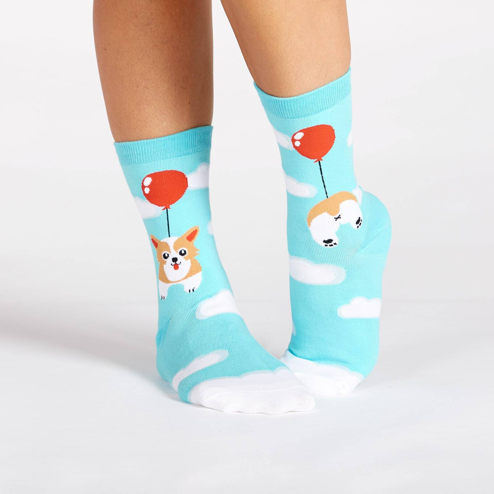 model wearing Pup, Pup, and Away Corgi Knee High Socks Blue - Women's