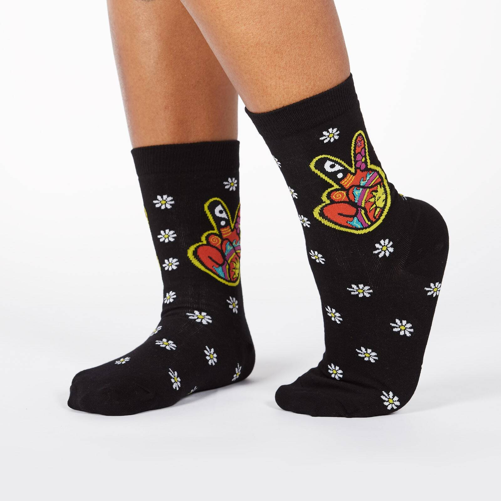 model wearing Dream of the '90s - Nostaglic 90's Kids Peace and Daisy Crew Socks Black - Women's
