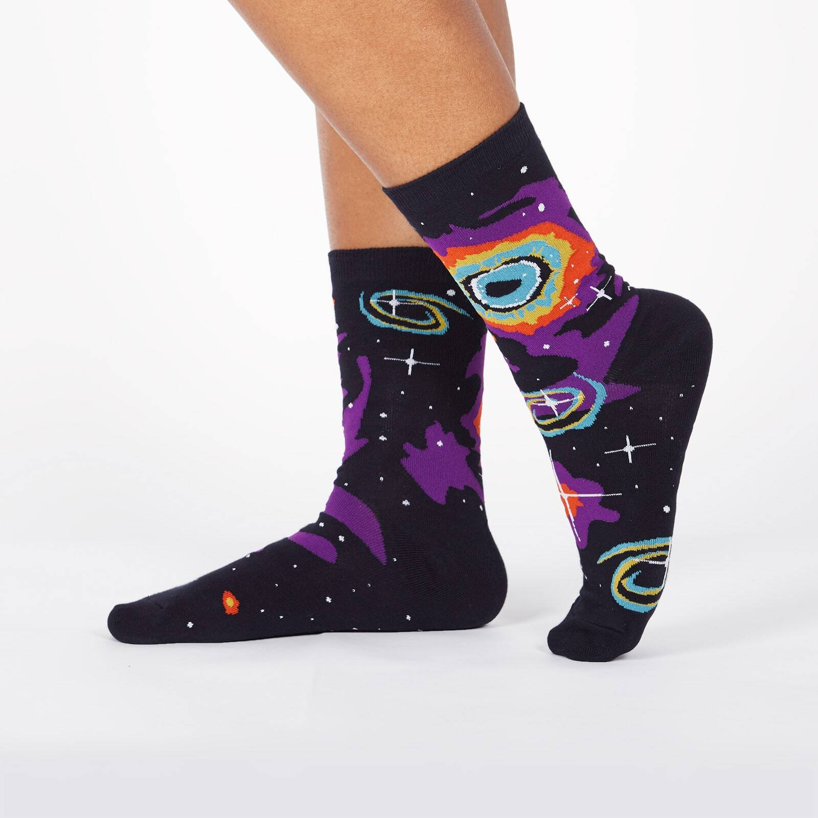 model wearing Helix Nebula - 50th Anniversary Moon Landing Outer Space Nebula Colorful Crew Socks Black - Women's