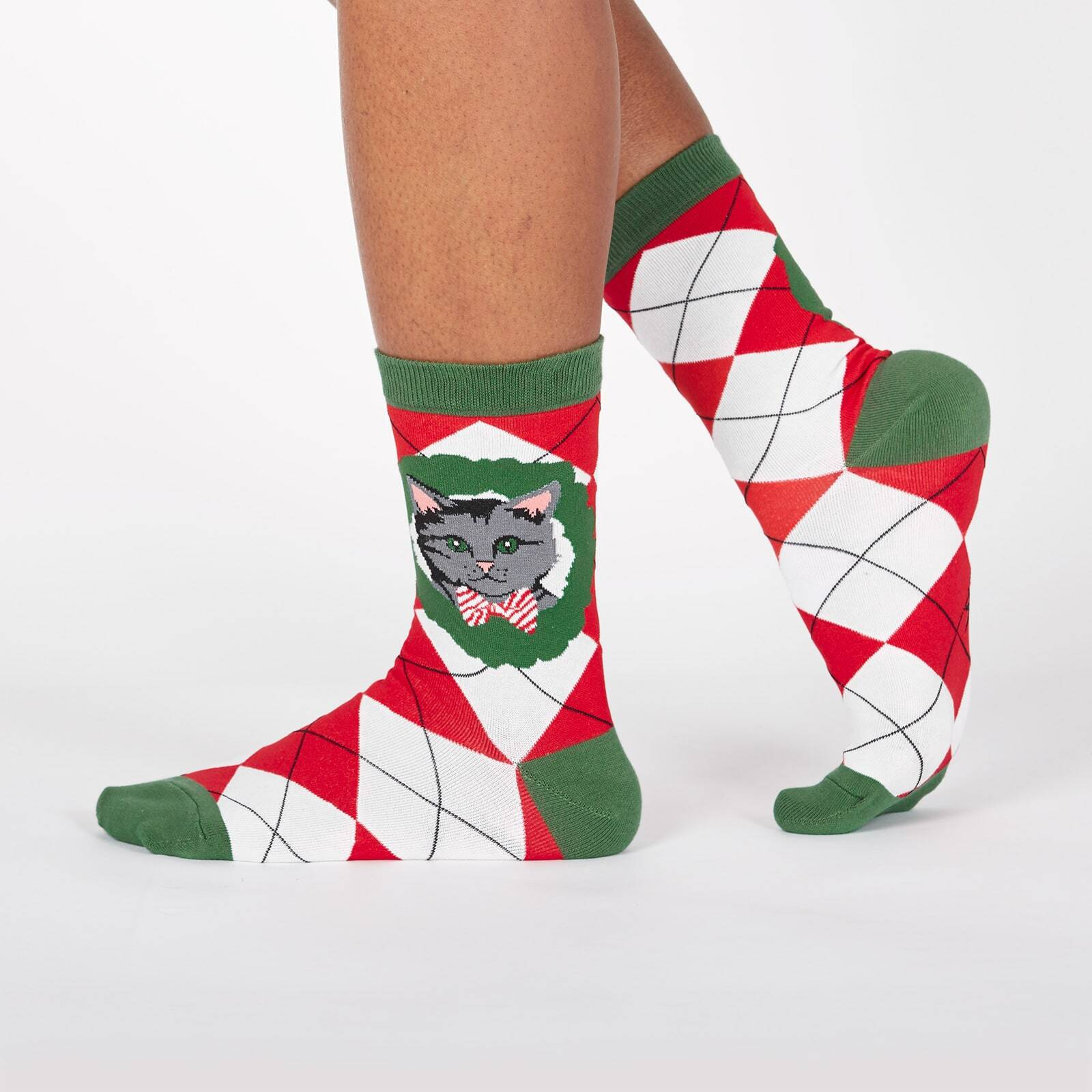 model wearing Deck the Paws - Dog and Cat Holiday Argyle Christmas Crew Socks Red - Women's