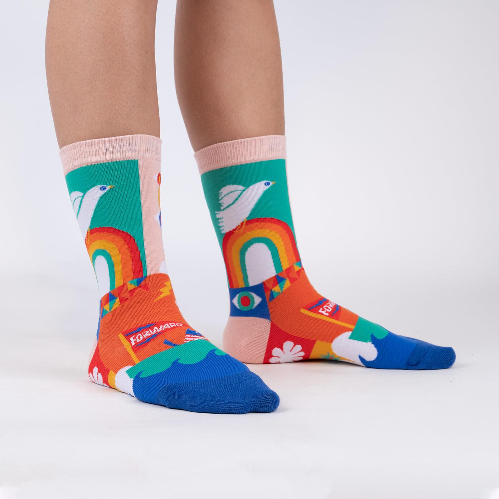 model wearing Peace and Love - Lisa Congdon Artist Crew Socks Pink - Women's