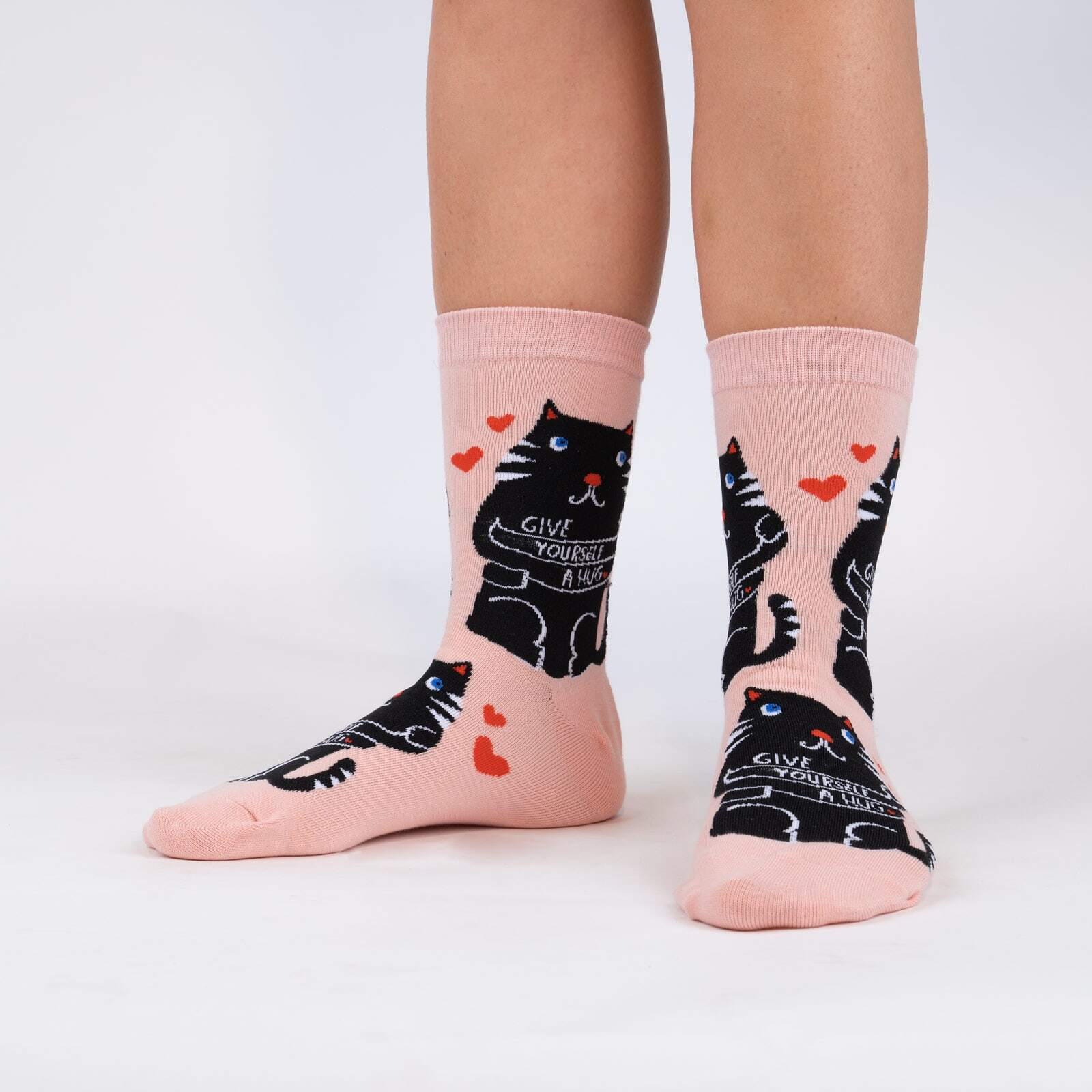 model wearing Love Yourself - Lisa Congdon Self Love Crew Socks Pink - Women's