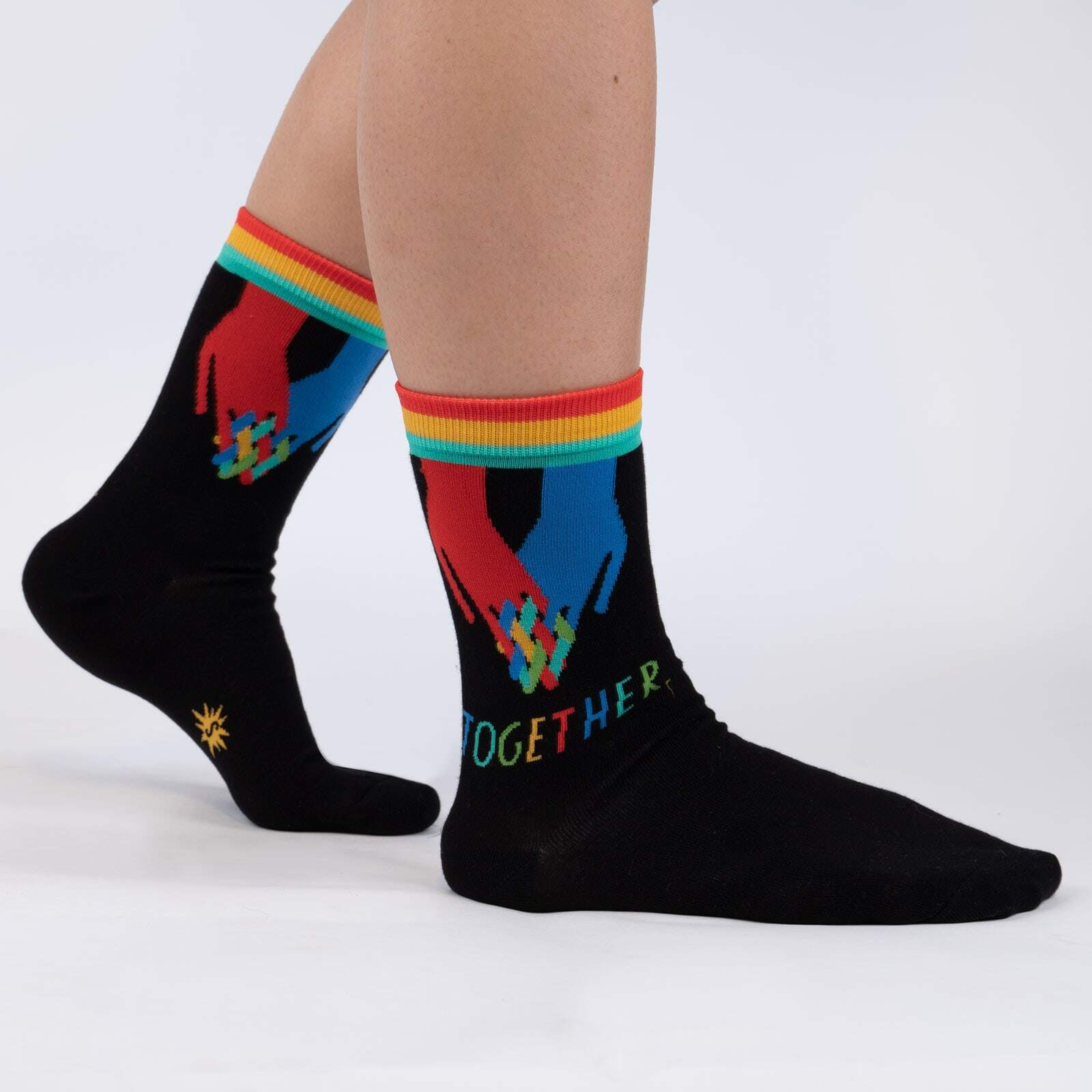 model wearing Together - Lisa Congdon Unity Statement Crew Socks Black - Women's