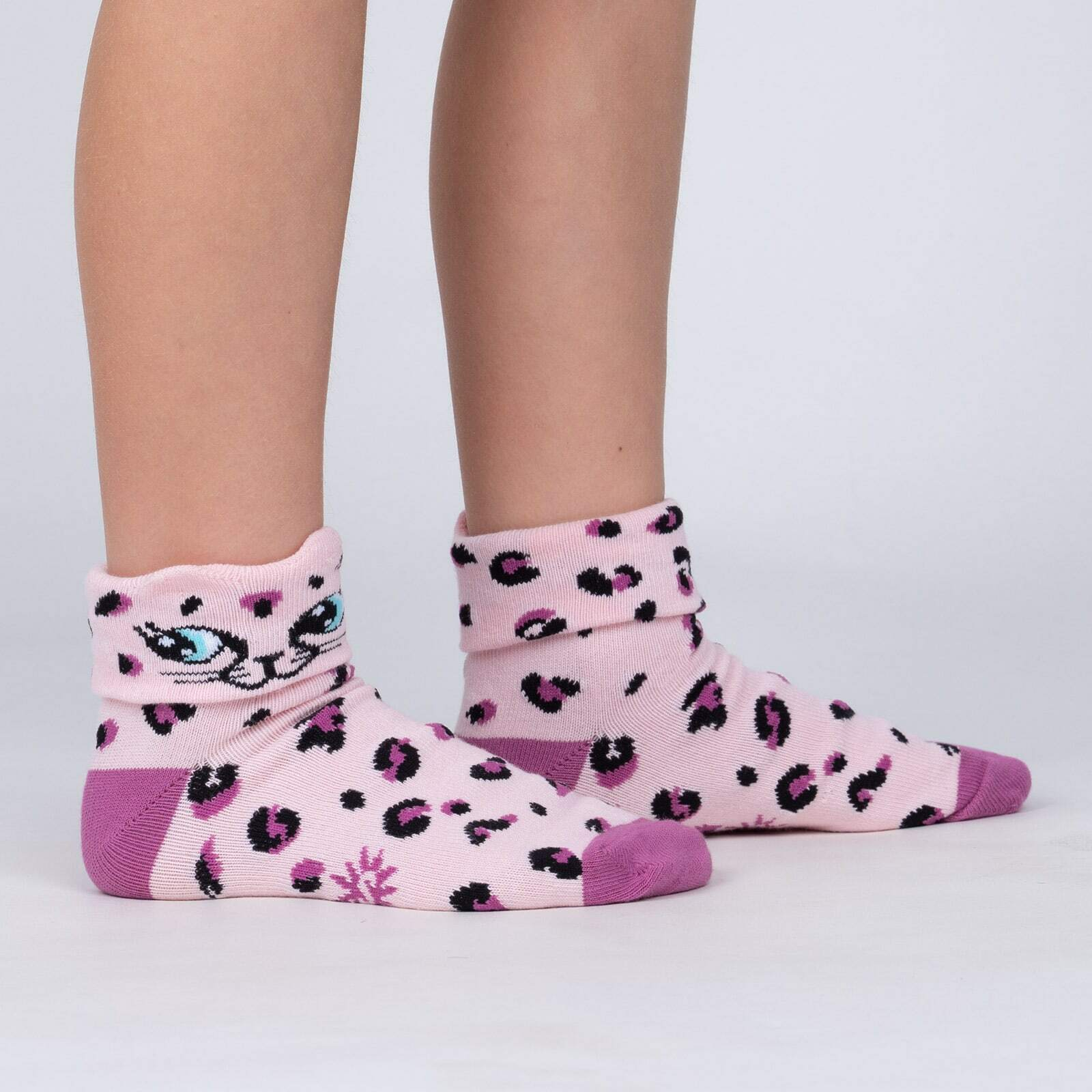 model side view of Check Meowt - Pink Leopard Turn Cuff Socks - Junior