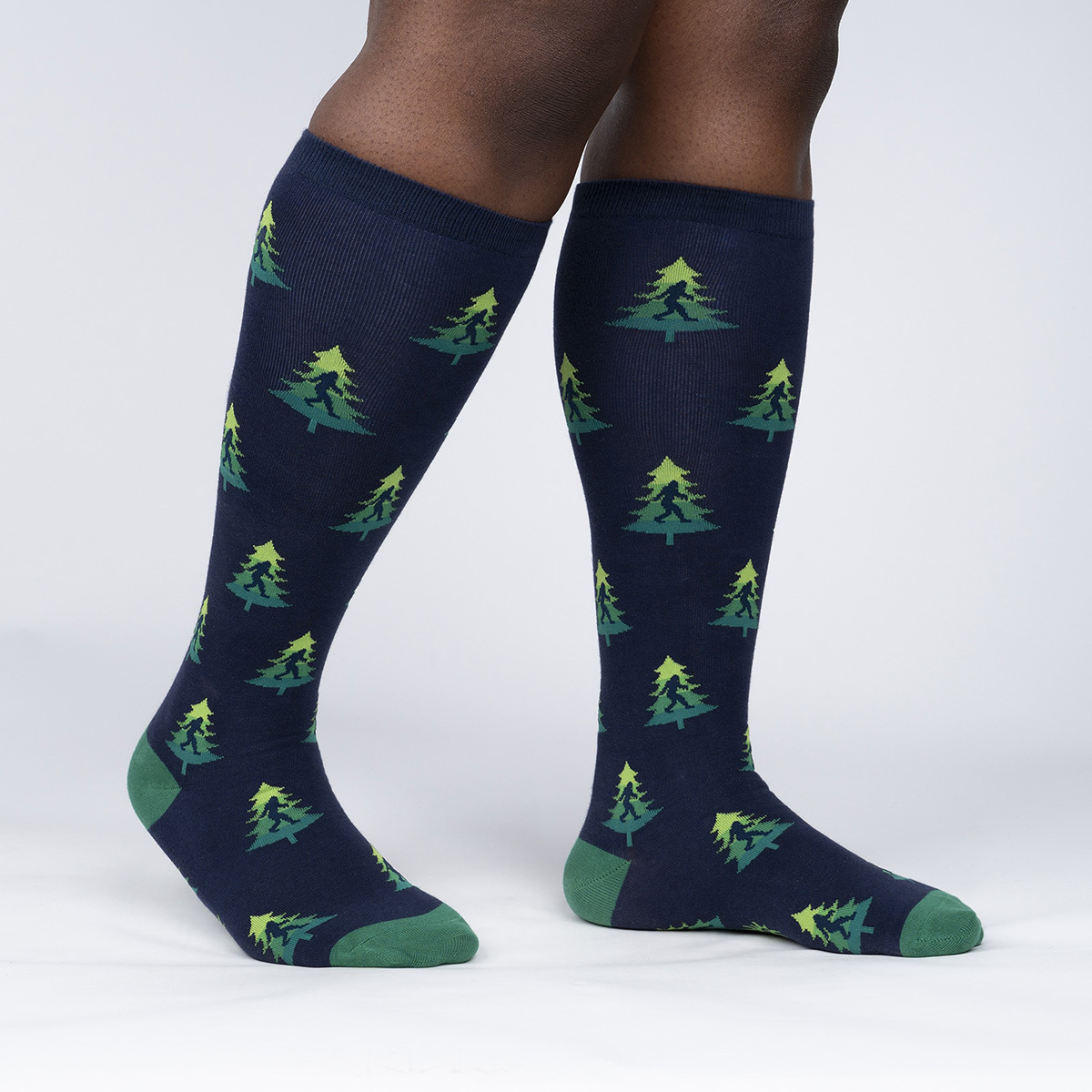 model side view of Do You Tree What I Tree - Sasquatch Forest Knee Socks - Unisex