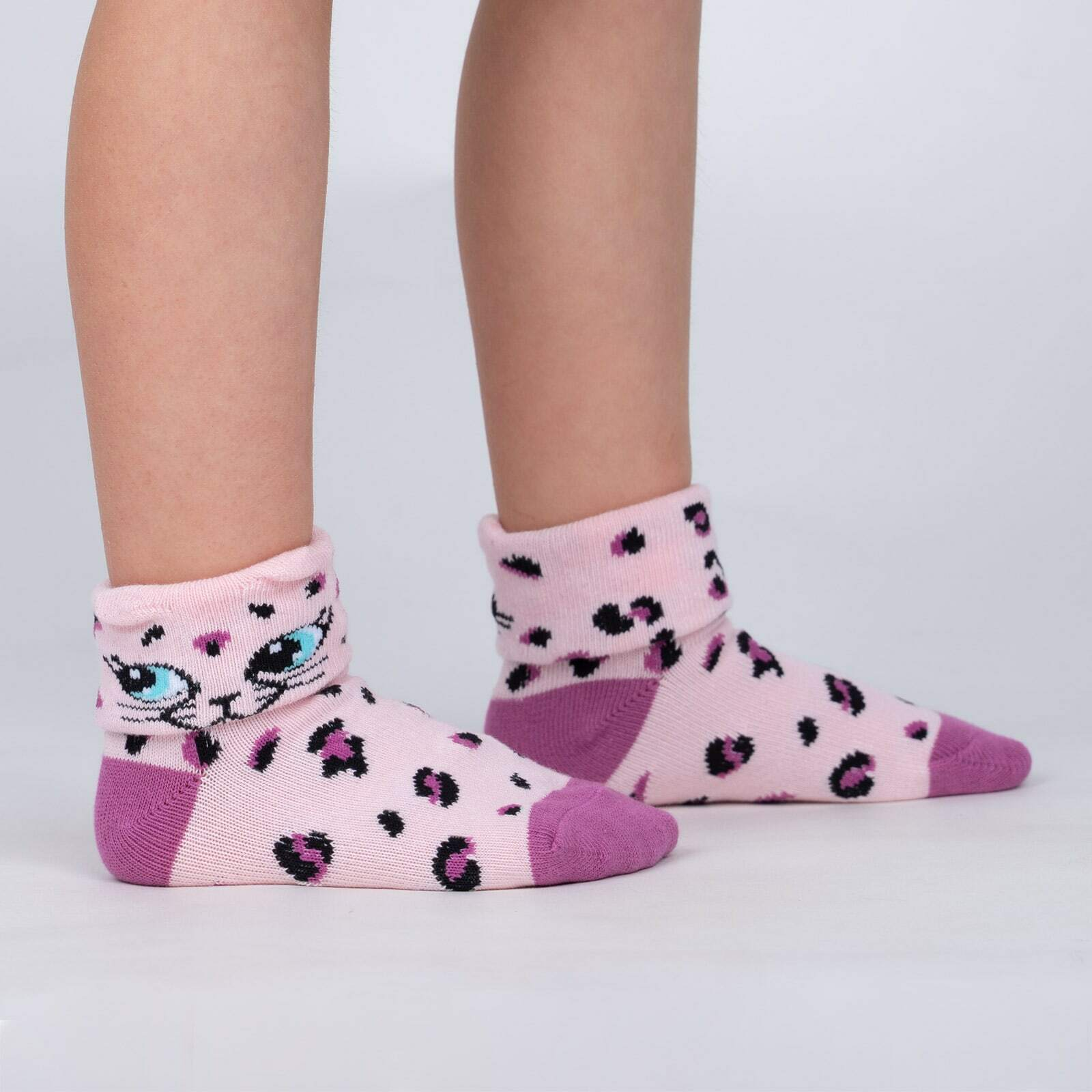 model side view of Check Meowt - Pink Leopard Turn Cuff Socks - Toddler