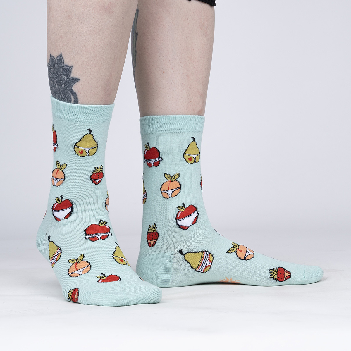 model wearing Main Squeeze - Funny Fruit Crew Socks - Woen's