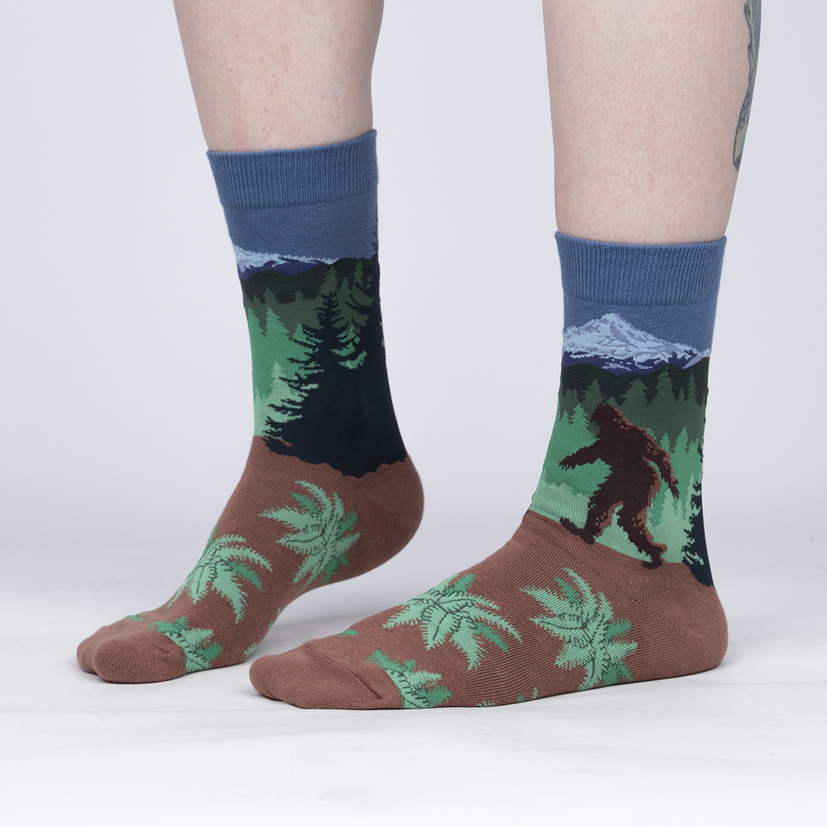 model side view of Welcome To My Hood - Sasquatch Forest Crew Socks - Women's